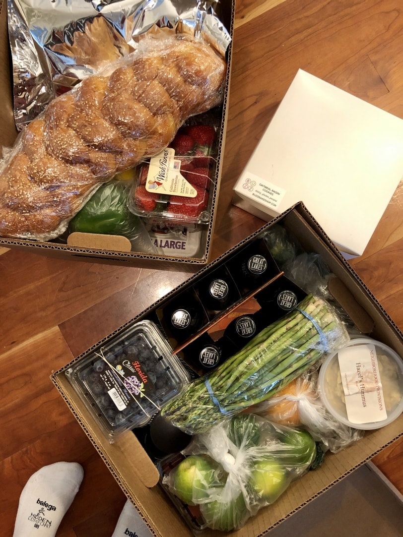 boxes of produce and prepared foods from neighborhood provisions