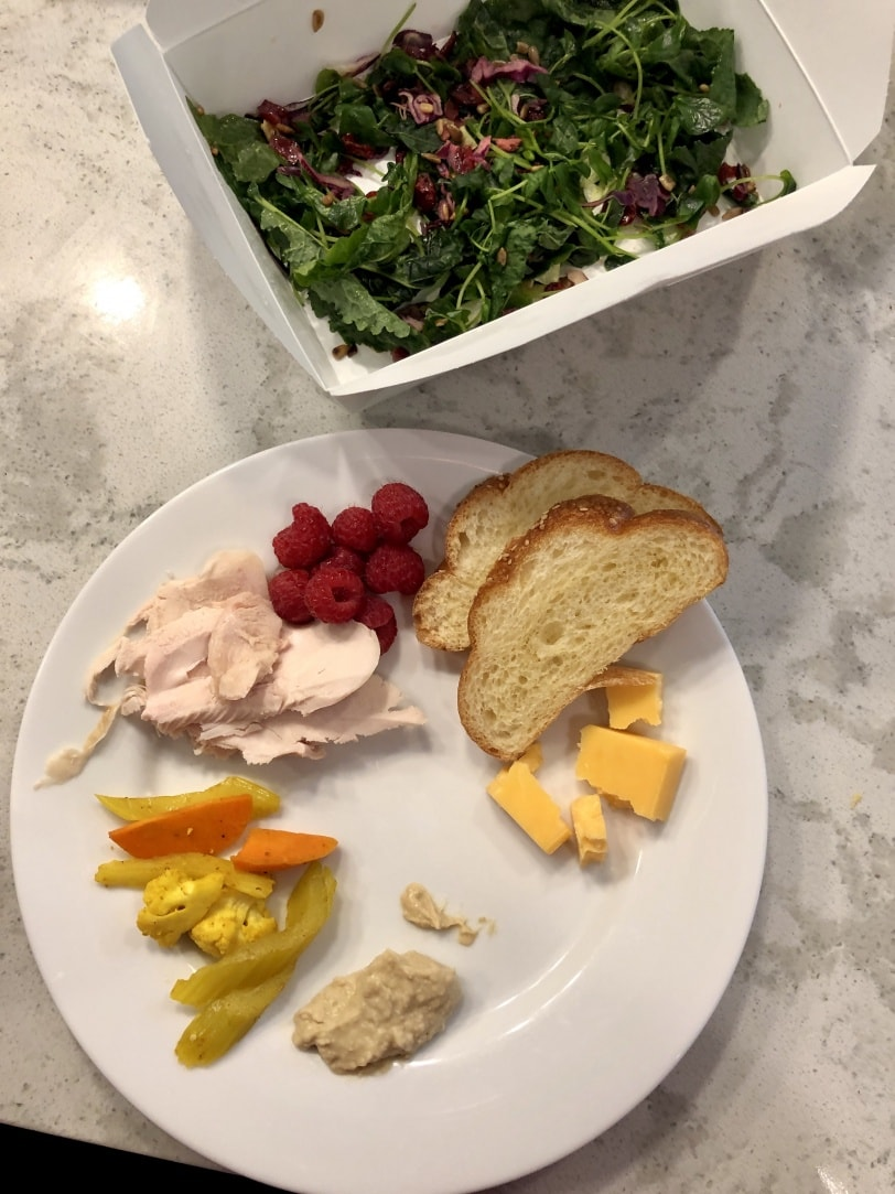 lunch plate with smoked chicken, cheese, pickled veggies, raspberry, bread, and leftover salad