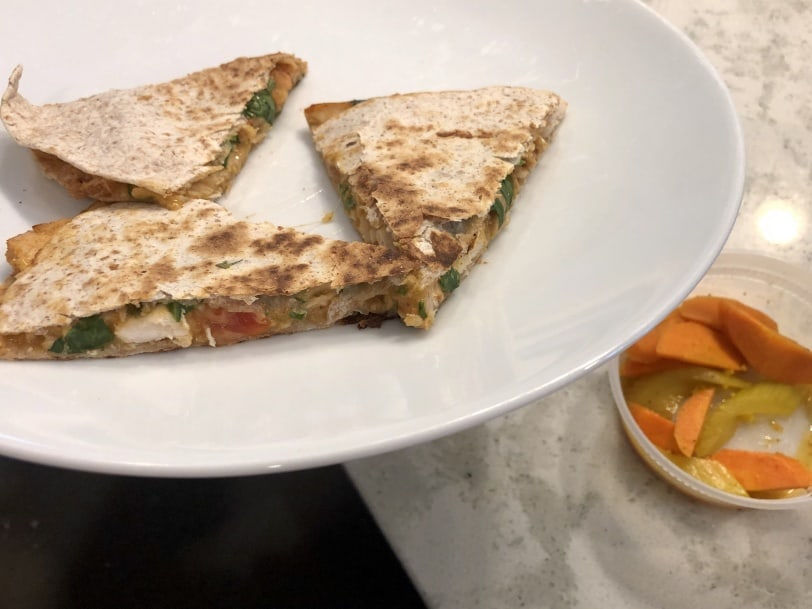 cheese tomato and chicken quesadilla with a side of pickled veggies