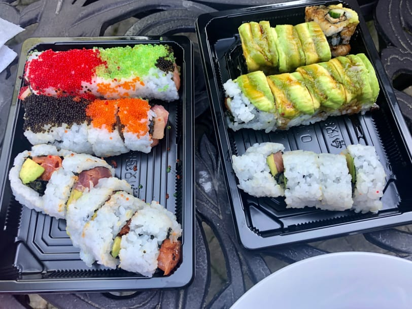 two boxes of sushi from sushi bar del ray