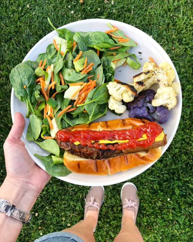 grilled dinner of sausage salad and cauliflower