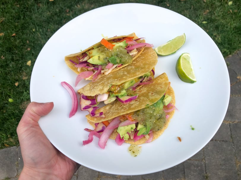 pork tacos with pickled onion and avocado
