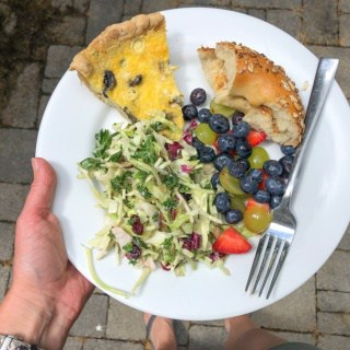 quiche, slaw salad, fruit, and bagel