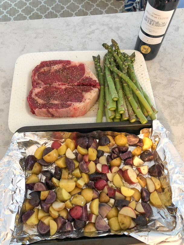 steak, asparagus, and potatoes before cooking