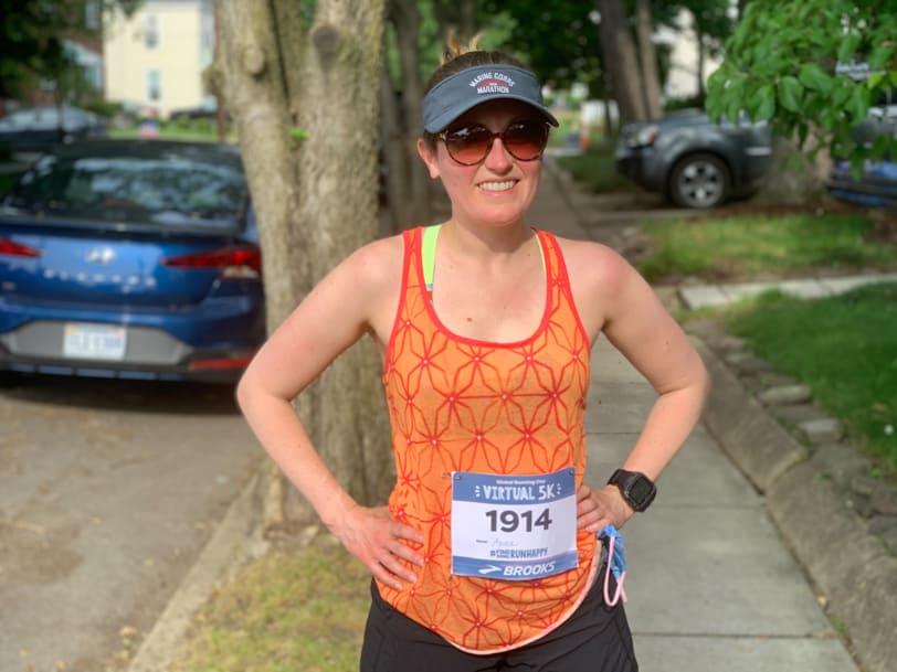 runner in an orange tank top