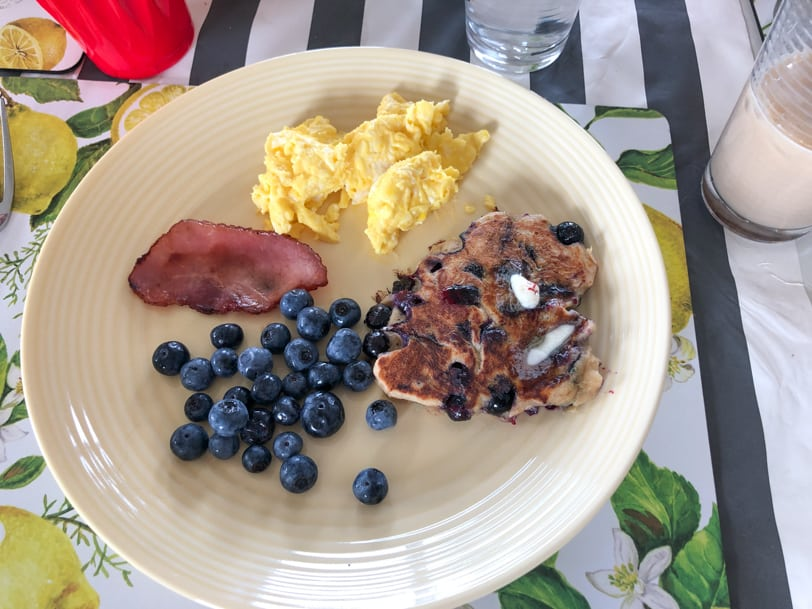 sourdough pancakes with blueberries bacon and scrambled eggs