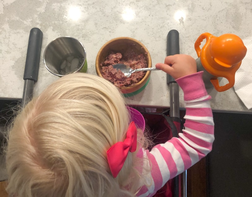 toddler eating oatmeal