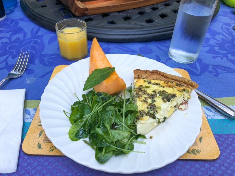 quiche and salad with cantaloupe