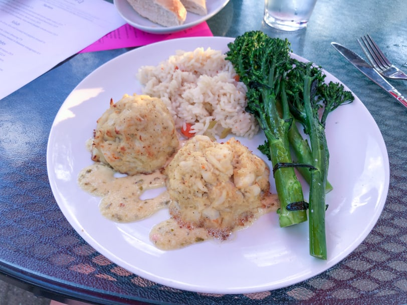 crab cakes, rice, and broccoli rabe from andora restaurant