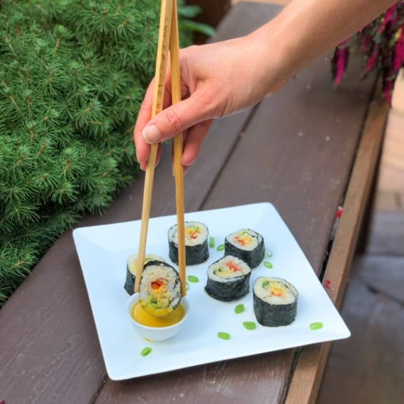 beefshi - sushi with roast beef, avocado, cucumber, cheddar cheese, red pepper, and mustard soy sauce