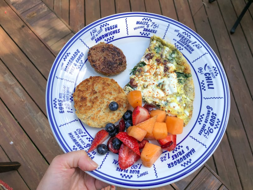 greek frittata with sausage, english muffin, and fruit