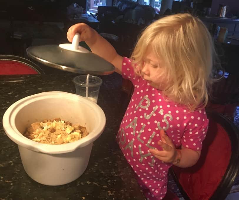 helping make overnight french toast casserole
