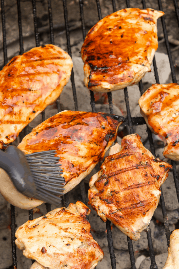 basting grilled chicken with balsamic glaze