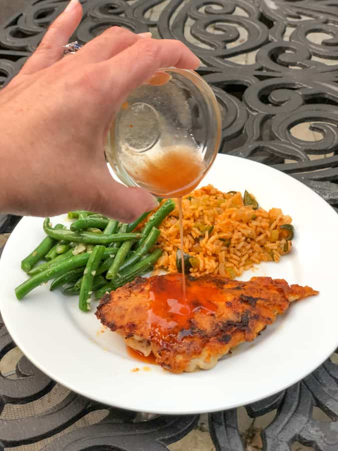 hot honey chicken with green beans and dirty rice