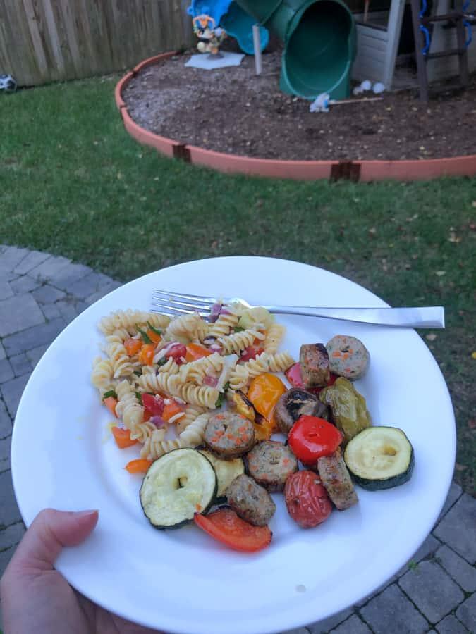 grilled sausage, veggies, and pasta salad
