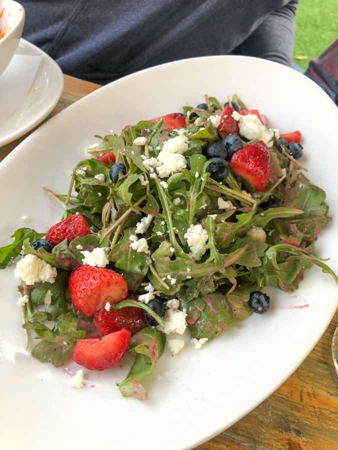 salad with berries and popcorn from eveningstar cafe