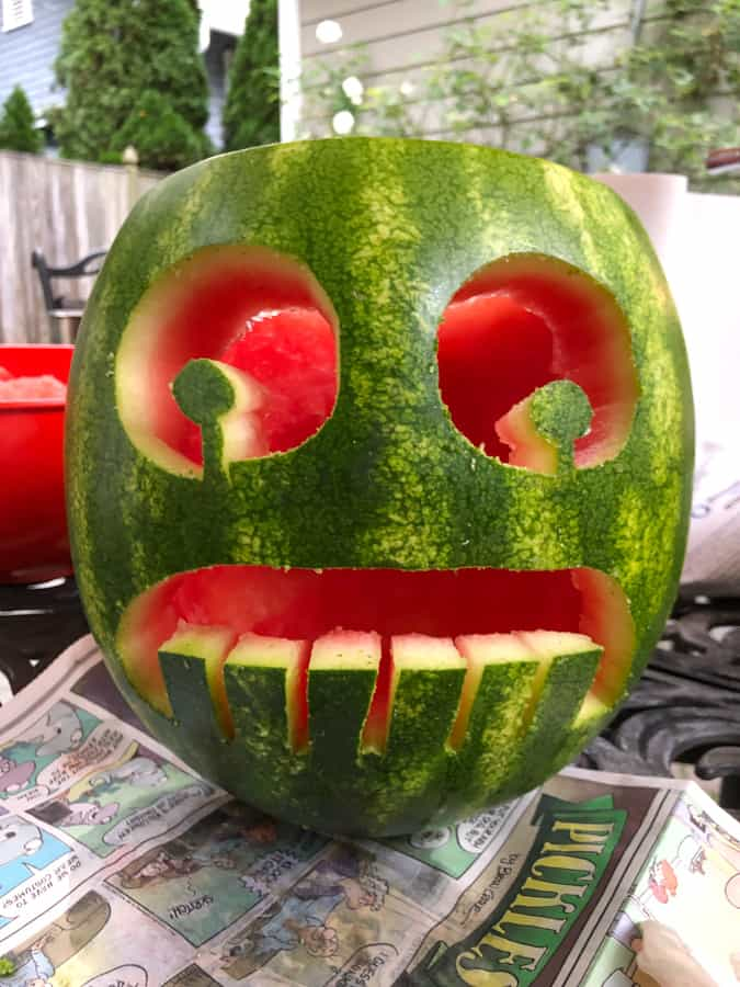 watermelon carved into a face with big teeth
