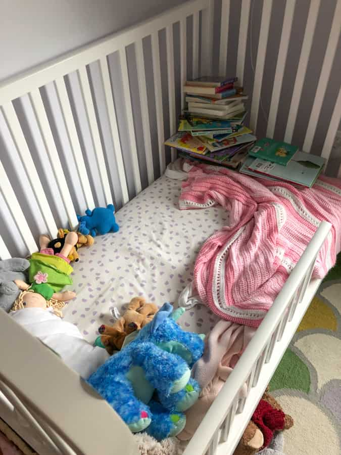 toddler bed with tons of books