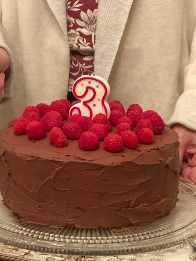 3 year old chocolate birthday cake with raspberries