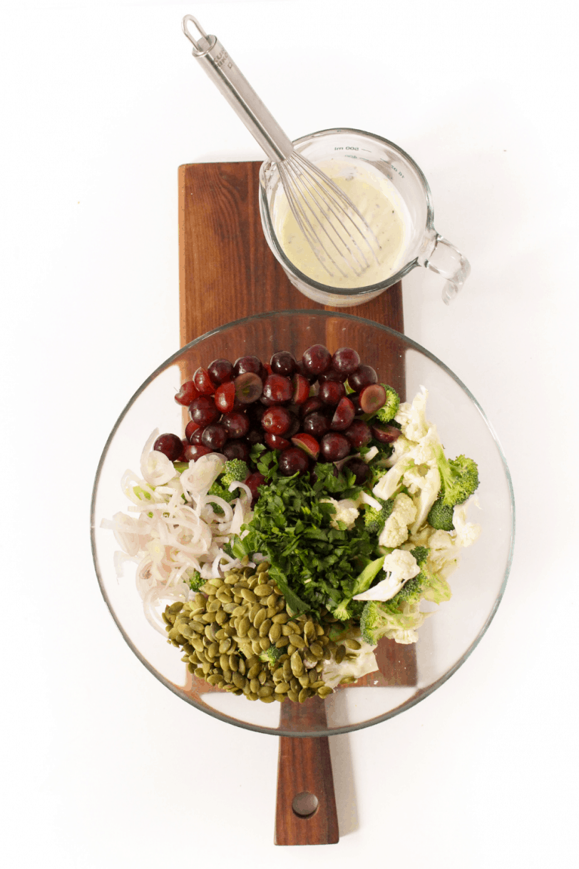salad ingredients chopped in a bowl with dressing on the side