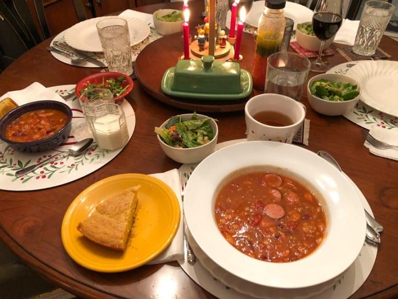 bean and sausage soup with cornbread and salad