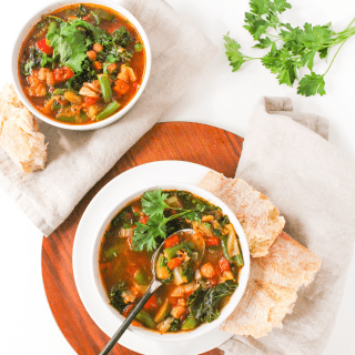 Instant Pot veggie soup in a white bowl