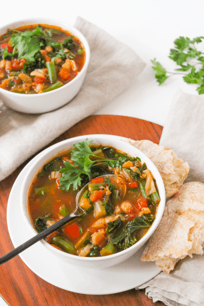 Instant Pot veggie soup on a wooden platter
