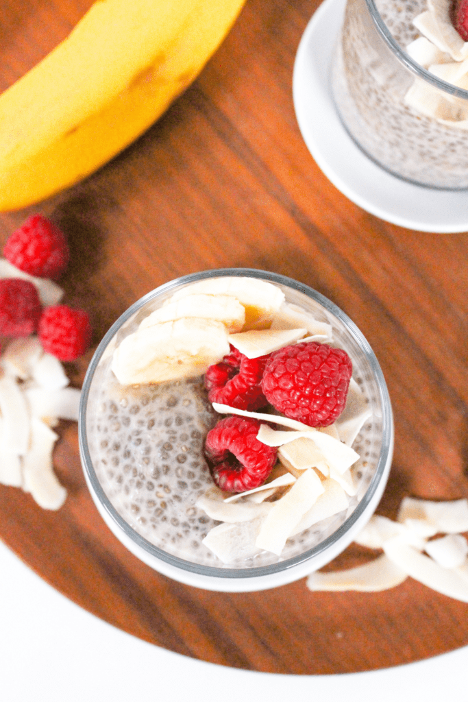 banana chia pudding with coconut milk and raspberries