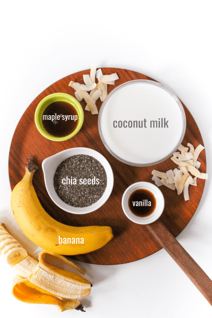 banana chia pudding ingredients: coconut milk, chia seeds, banana, maple syrup, vanilla extract, and unsweetened shredded coconut or coconut flakes