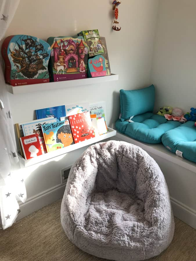 toddler reading nook with floating shelves