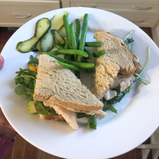 turkey sandwich with cheese, pickles, string beans