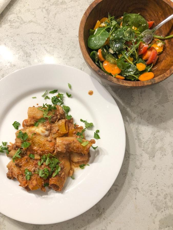 baked rigatoni with lamb ragu and salad