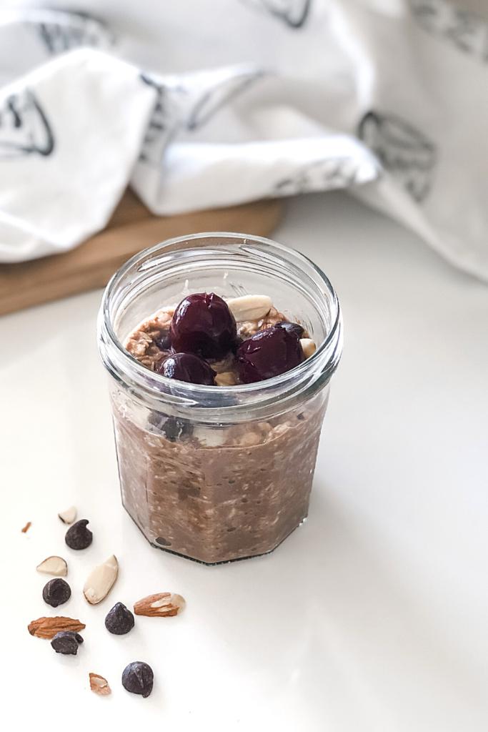 cherry chocolate oatmeal in a mason jar