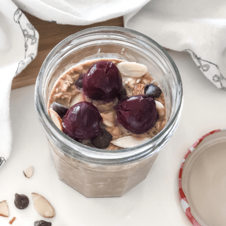 cherry chocolate overnight oats in a jar