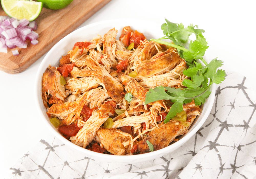 crockpot mexican shredded chicken in a white bowl