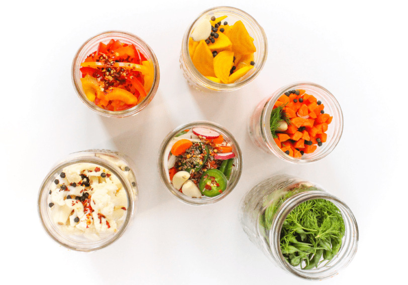 flatlay of fermented vegetables in mason jars