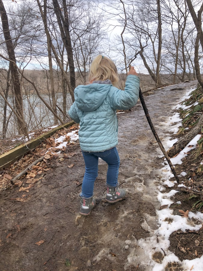 toddler hiking up a hill