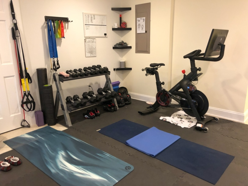 home gym basement set up with peloton and weights