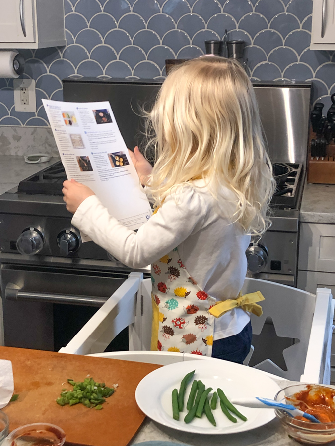 toddler helping making dinner with blue apron