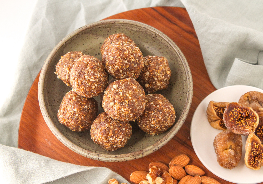 vanilla protein balls with figs and nuts on a plate