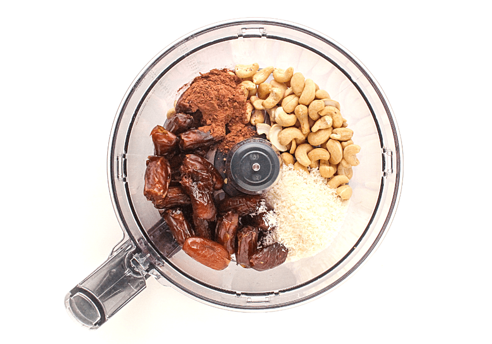 chocolate cashew energy bites ingredients in a food processor