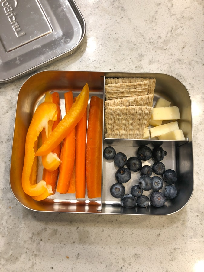 crackers and cheese, blueberries, peppers and carrots