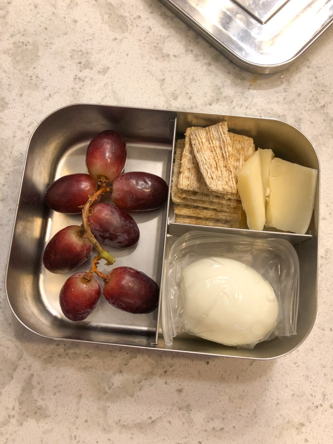 grapes, hard boiled egg, crackers and cheese