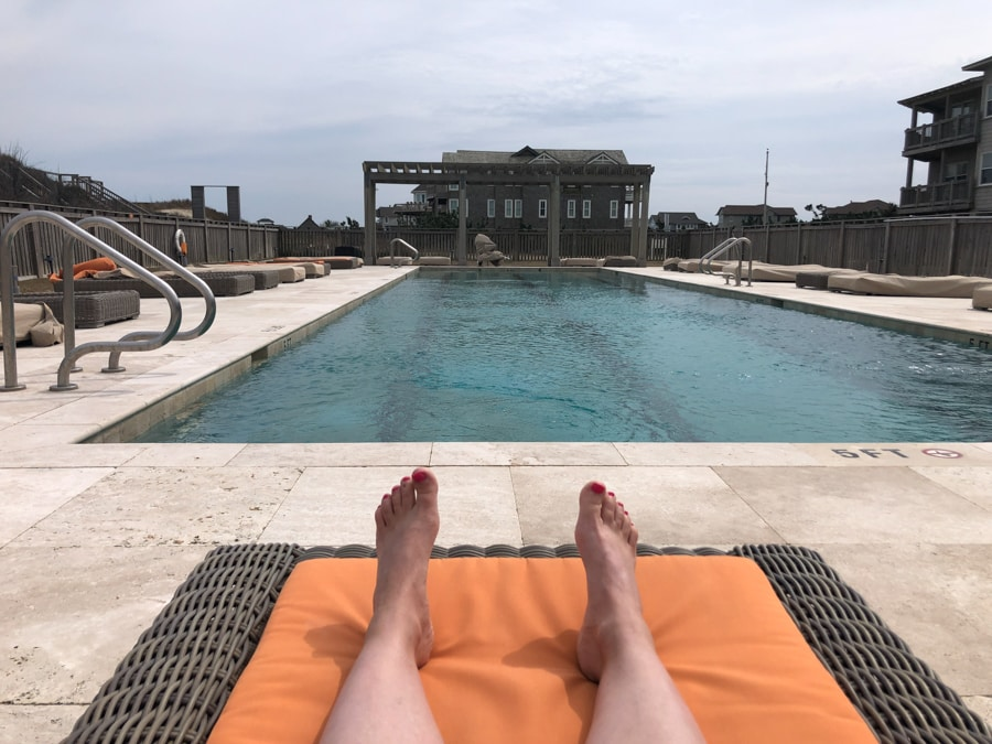 sitting at the pool at the sanderling resort