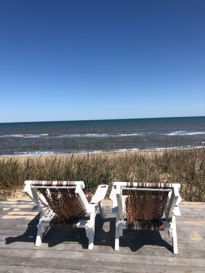 chairs with a view of the ocean at the sanderling resort