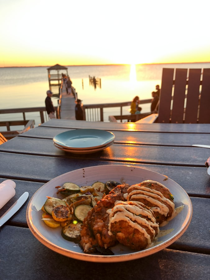 crab cakes with a sunset view at NC coast restaurant in Duck