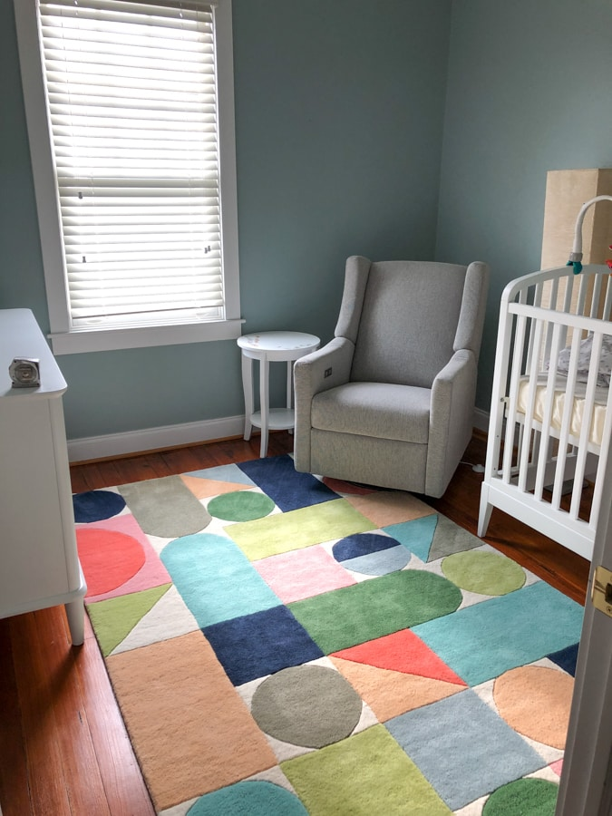 baby boy room with colorful rug