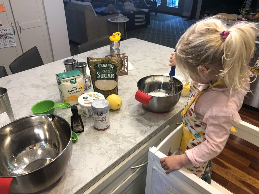 toddler helping make pancakes