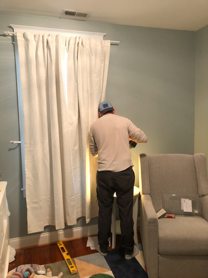 installing blackout curtains in baby's room