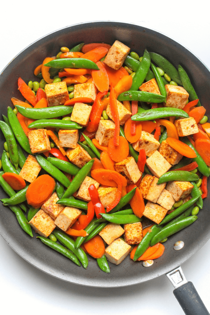 stir fry in a skillet with tofu and vegetables
